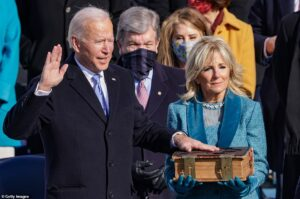 Biden takes office promising to adopt a collegiate approach to both foreign and domestic affairs