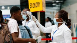 Nigeria Immigration Service officials seize woman's passport for asking them wear facemasks