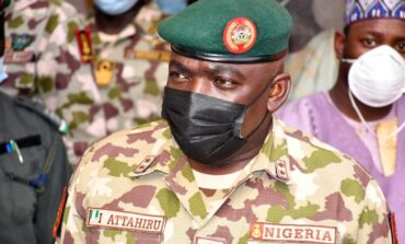 Buhari pledges to step up fight against insecurity so army boss and 10 others would not die in vain