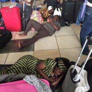 New coronavirus restrictions hit air passengers hard as curfew forces them to sleep at airports